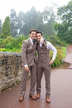 The groom wears a brown suit and blue bow tie | Photography by http://www.kimberleybrand.com/