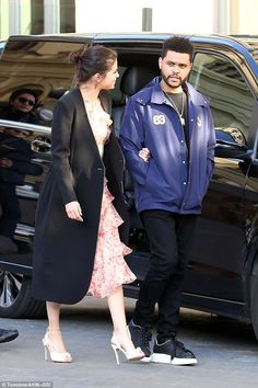 The look of love: Selena gazed adoringly at her beau as they strolled...
