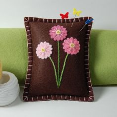 Three Pink Daisies on Brown Wool Felt Pincushion / Small Pillow by TheBlueDaisy, via Flickr