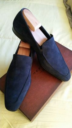 Navy blue suede slip-on loafers by Mezlan