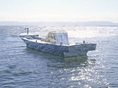 Artists Hiromi Tango and Craig Walsh's mirrored fishing boat, Traces: Blue, is nearly invisible to the eye.
