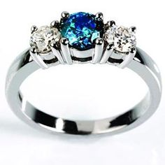 Such a pretty ring. I really like the color of the gem