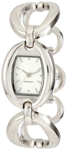 Nine West Women's NW1187SVSB  Silver-Tone Oval Link Bracelet Watch Nine West. $59.00. Silver-tone hour hands. Oval silver-tone polished bezel. Sweep second hand. Silver-tone adjustable link bracelet with jewelry clasp closure and extender. Silver-tone dial with silver-tone index markers. Save 14%!