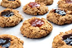 Oat Jam Thumbprint Cookies  Ingredients      1 tablespoon chia seeds or flax seed meal     3 tablespoons almond milk     1 cup rolled oats (I used GF)     1/4 cup coconut sugar, turbinado or pure cane sugar     1 teaspoon cinnamon     1/2 teaspoon baking soda     1/2 teaspoon baking powder     1/8 teaspoon himalayan salt     3 tablespoons coconut oil (in it's melted state)     1 tablespoon pure maple syrup     2 tablespoons almond butter, optional     1 teaspoon vanilla extract     100% fruit j…