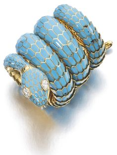 This diamond and enamel bracelet by Bulgari is decorated with turquoise enamel, the eyes set with pear-shaped diamonds. (Via Sotheby's.)