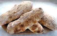 Ciabatta is Italian for 'old slipper' and is pronounced 'cha-bah-ttah'. Ciabatta makes panini when grilled and toasted halves are 'bruschetta' pronounced 'bru'sketta'. This is absolutely the best recipe for homemade ciabatta loaves. Food N, Food And Drink, Cooking For A Crowd, Latest Recipe, Ciabatta, Tray Bakes, Soul Food, Allrecipes, Tapas