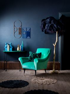 The Tango chair in Estelle Teal is positoned in between a purple ostrich feather lamp and a flamingo console table. Introducing Matthew Williamson's first ever bespoke furniture collection. Created in collaboration with Nottingham-based sofa manufacturer Duresta, the designs comprise five upholstery ranges and unique occasional pieces.