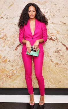 Solange Knowles wearing a hot pink Gucci suit set and seafoam green clutch. This color combo is TO DIE