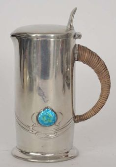 Archibald Knox - Liberty & Co - A Tudric polished pewter cylindrical hot water jug