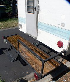 Truck Camper : porch/deck   Motorcycle carrier