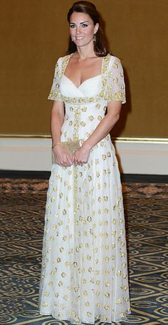 Catherine attended an official dinner hosted by Malaysia's Head of State on Day 3 of hers and Prince Williams' Jubilee tour of Asia. She chose a white Alexander McQueen dress embroidered with golden hibiscus flowers, the national flower of Malaysia.
