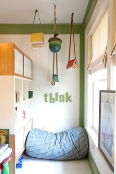 use a bookcase to create a little reading/play nook. ❤ it!