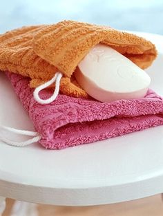 Stitch the edges of two washcloths for double-duty bath accessories -- a small bag for soap and the perfect scrub cloth.