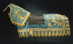 Tornerschabrak med fast bogstycke, sytt av täckemakaren Hans Casper till Gustav II Adolfs bröllop 1620.