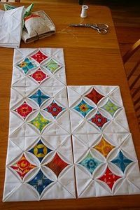 Cathedral Window Quilt Blocks - I like the way these are arranged in groups off four around the negative space.