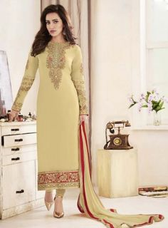 #Yellow Georgette #Straight #Churidar #Suit Features on georgette fabric top with heavy embroidery, zari, thread and stone work, santoon bottom and matching chiffon fabric dupatta.