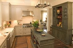 Kitchen built around an antique piece used as an island. Side hutch distressed and finished to match. by Plan View, via Flickr