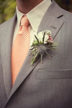 The Groomsmen are wearing heather grey suits and peachy, pink ties. This is a good example of the look we are going for.