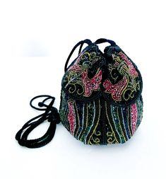 Excited to share the latest addition to my #etsy shop: Flapper Style Beaded Drawstring Evening Bag, Intricate Glass Beads, Black Red Blue Green, All Over Pattern, Handmade, Vintage Gift for Her