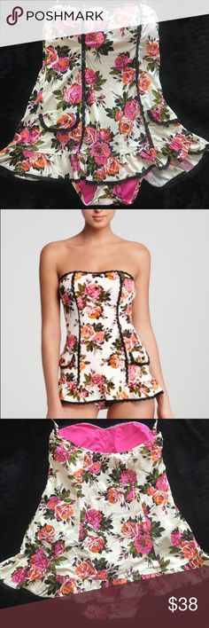 Betsy Johnson swim dress M Bright floral on white background Betsy Johnson swim dress. Size medium. Lined cups, detachable halter strap. Betsey Johnson Swim One Pieces