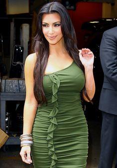 Kim Kardashian wearing a green dress while leaving ABC studios in New York City on April 6, 2010