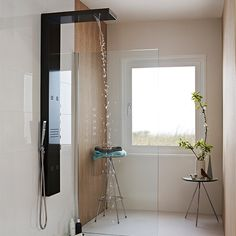 Doesn't this shower looks amazing? This wet room is a stunning example of how effective a contemporary bathroom design can be. Click through for ideas and inspiration on how to achieve a similar look in your home. Shower Panels, Big Bathrooms, Bathroom Shop, Wet Room Shower, Shower Tower, Contemporary Bathrooms, Diy Plumbing, Contemporary Bathroom Designs, Bathroom Decor