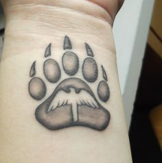 My other tattoo, bear paw with a bird in the middle. #bearpaw #bear #bird