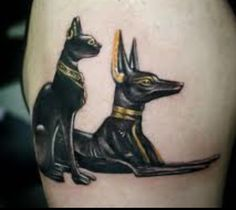 Someone's online post of their Anubis and Bastet tattoo. Love this one.