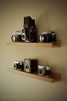 My vintage camera shelf. All fully working and had a roll of film or two…