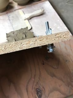 Perfectly rolled coils using a board, nuts & bolts as a template!