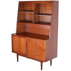 Kipp Stewart; Walnut and Brass Breakfront Cabinet, 1950s.