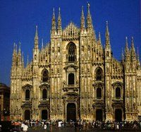 Duomo di Milano The Duomo is constructed entirely of marble is a Blossomed Gothic style. It has 3400 statues, is 158 meters long and 93 meters wide, and reaches 108 meters in height. In 1774, on the highest spire a gold statue of the Madonna was placed to protect the city.