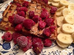 Breakfast  Peanutbutter Waffles with banana and Raspberries