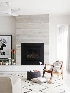 """**Place a stylish chair by the fire –** and don't forget a good book too! Now just sit back and enjoy all the cosy pleasures that winter has to offer. See more of this [east Melboure home](http://www.homestolove.com.au/gallery-scandi-style-renovation-brings-bungalow-to-life-2053