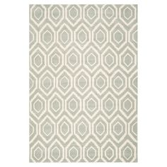 Wool rug with a Moroccan tile motif. Hand-tufted in India.   Product: RugConstruction Material: WoolColor: Grey and ivoryFeatures:  Made in IndiaHand-tufted Note: Please be aware that actual colors may vary from those shown on your screen. Accent rugs may also not show the entire pattern that the corresponding area rugs have.Cleaning and Care: Professional cleaning recommended
