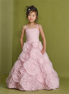 This dress is made from a designer that is committed to designing dresses of couture quality, unique designs, and LOTS of details. This romantic style is one that will leave a lasting impression on all those who lay eyes on your little princess. The lightly gathered bodice is classic in design. The ruffle skirt features layers of taffeta that resemble a bed of roses. The dress is fully lined for complete coverage to ensure that your princess stays comfortable.