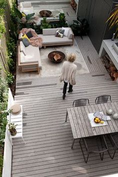 MillHill Terrace - modern - patio - sydney - by ANNA CARIN Design-wood and concrete deck to denote separate areas. Space between deck and wall for planting beds. Mirror along background wall for an illusion of space. Sitting options. Cupboard in far right