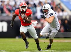 Sony Michel #1 of the Georgia Bulldogs in action during the TaxSlayer Bowl game against the Penn State Nittany Lions at EverBank Field on January 2, 2016 in Jacksonville, Florida.