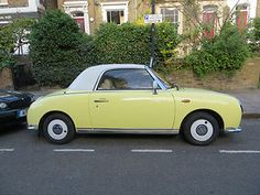Yellow Nissan Figaro - my dream car :) (aside from the Land Rover :P)