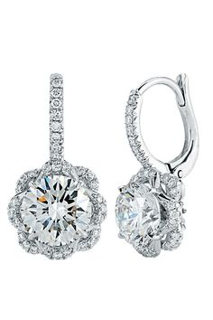 Flower Inspired Round-Cut Diamond Drop Earrings; Nature inspires a setting that showcases two Round-cut Brilliant Diamonds. The Diamonds: 1.51 Carats and 1.51 Carats make a beautiful match and are highlighted by 68 Diamonds set pave of Total Carat Weight 0.32.