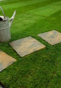 Square paving stone path on a lawn