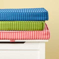 like the idea of a cushion attached to the top of a toy box.