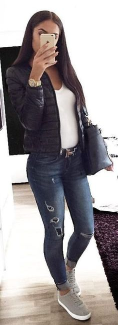 #winter #fashion / Black Puff Jacket / White Top / Ripped Skinny Jeans / Grey Sneakers