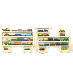 Hey, I found this really awesome Etsy listing at http://www.etsy.com/es/listing/110056847/wooden-wall-storage-train-rack-organizer