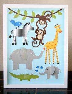 This is paper collage with three-dimensional elements. All the animals are cut, assembled, and folded by hand from heavy cardstock. The background is a sky blue canvas. Children Art Jungle Art jungle animals wall art for kids jungle giraffe hippo alligator lion elephant boy infant nursery baby toddler zoo