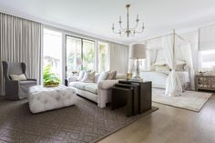 After welcoming a baby boy, two parents turned to Marie Flanigan to create a spa-inspired, multipurpose master suite. The result was a soothing space which married their styles while creating areas where everyone could feel comfortable -- even the family dog.