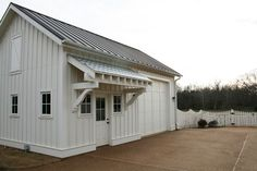 Detached Garage+ Studio or mother in law cottage. Love the board + batten siding.