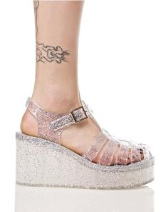 Shimmer 'N Shine Jelly Platforms. My feet would look so dumb in these but I kinda still want to try...
