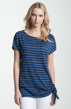 This tee (MICHAEL, Michael Kors) is long, so the butt of your gun won't play peek-a-boo with the people in line behind you at Starbucks. The dark color and stripes help keep the gun bump from being visible. Conceal in an IWB behind the hip.