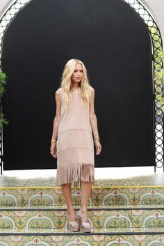 Rachel Zoe - Tip: Accessorize a neutral frock with nude heels and chunky gold accessories.Photo: Billy Farrell / BFANYC.com